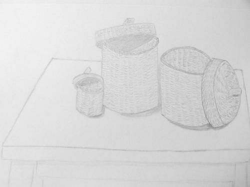 161- Baskets on a table.